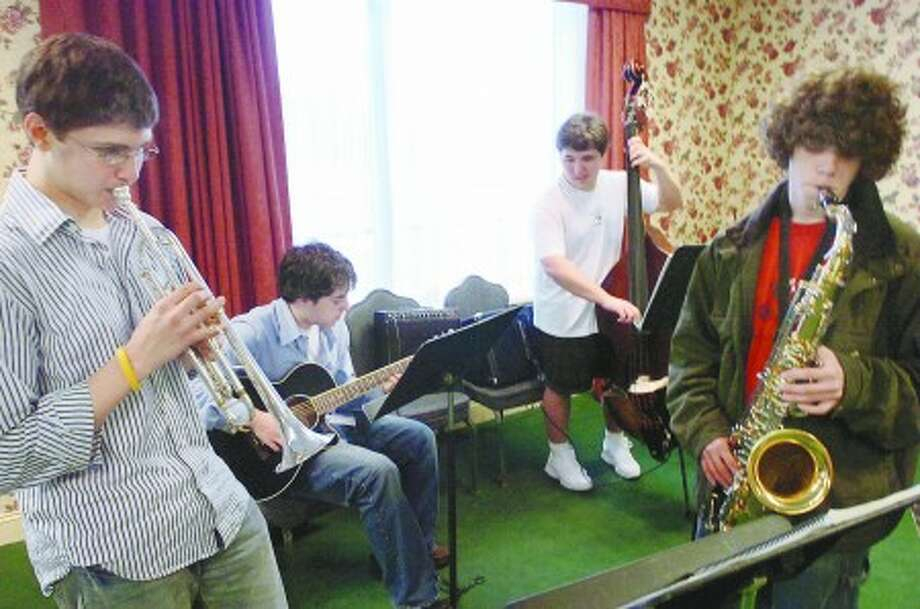 Area residents play at the Italian Center in Stamford as part of the winter jazz series, from left, Justin Avellar on trumpet, Guitarist Joe Conte, Joe Hull on Bass and Joey Howlett saxophone/photo matthew vinci