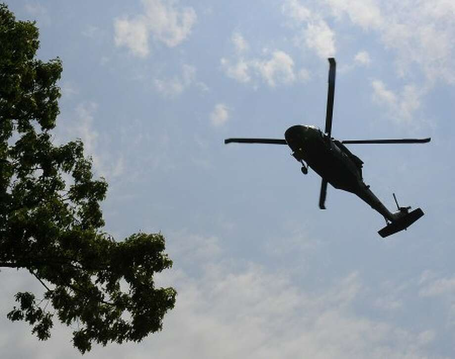 Two helicopters from the Connecticut National Guard made low passes twice over Rowayton''s Memorial Day parade on Saturday.