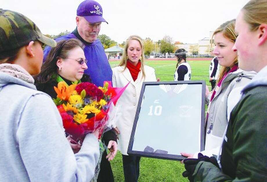 Kendall Turek, a former NHS field hockey player who was killed in a motor vehicle accident in September, had her jersey retired and presented to her sister Jessica Turek, mother Diane Turek, father Tom Turek and cousin Stephanie Rocco by former players Jessica Bruno and Elyse Lyons before the team''s gameSaturday against Fairfield Warde. Hour photo / Erik Trautmann