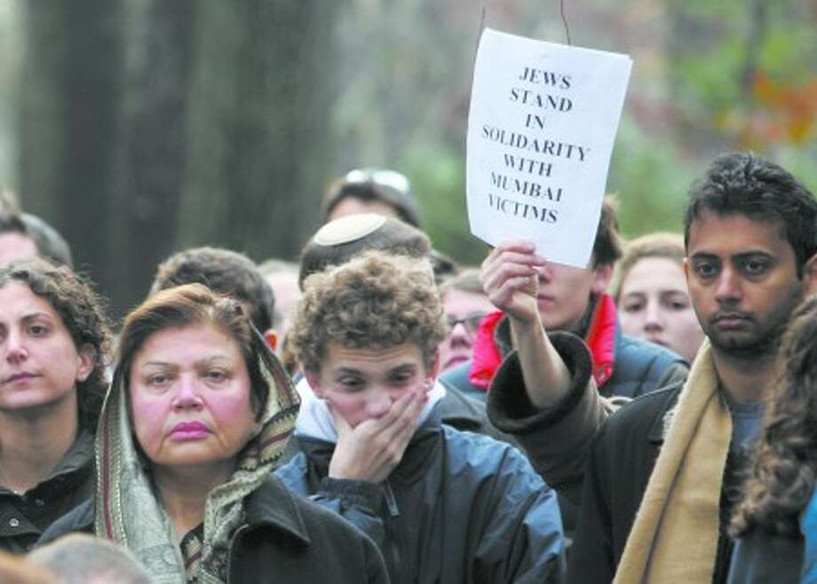 People participate in a vigil organized by the Jewish community in solidarity with victims of the attacks in Mumbai, India, near the Indian Mission in New York, Monday Dec. 1, 2008. At least 172 people died and 239 were wounded during the Mumbai attacks last week. (AP Photo/Bebeto Matthews)