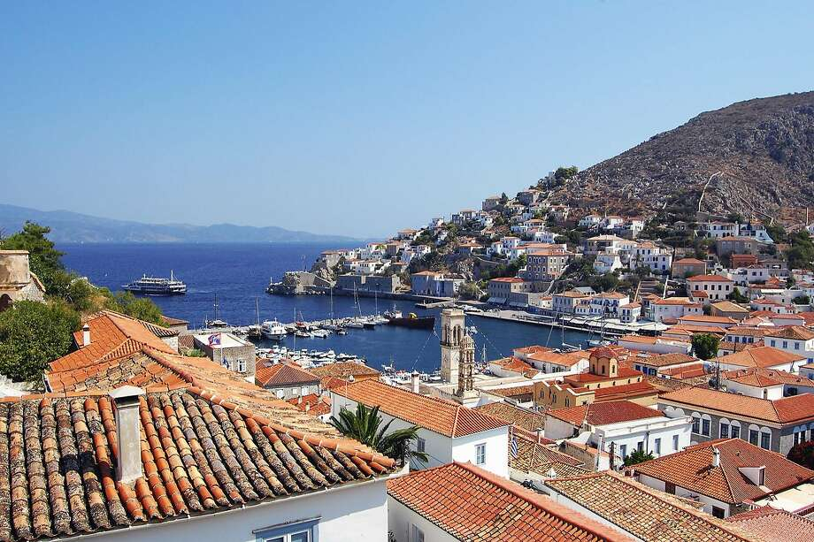 Memorable seaside views, whitewashed homes and well-worn harborside cafes combine to make Hydra an ideal Greek isle. Photo: Rick Steves