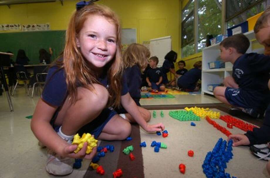 Photo/Alex von Kleydorff. 6yr old Marygrace Dellisanti during free play in Kristin Mazzeo''s 1st grade class at Our Lady of Fatima in Wilton. The school has just won a Blue ribbon.