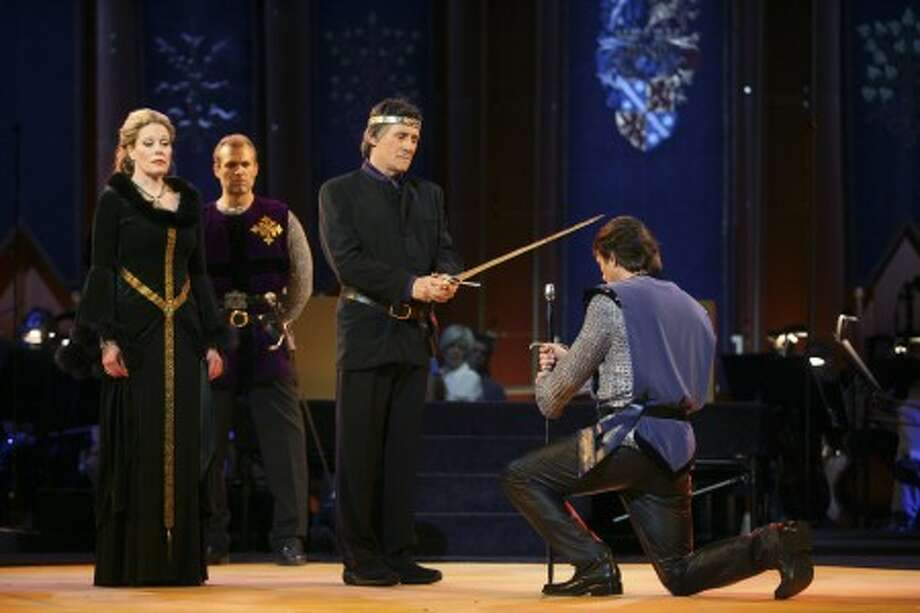 "Nathan Gunn, right, performs as Lancelot alongside Marin Mazzie, left, performing as Guenevere and Gabriel Byrne Performing as King Arthur in the New York Philharmonic''s performance of Lerner and Loewe''s ""Camelot"" Wednesday, May 7, 2008 in New York. (AP Photo/Mary Altaffer)"