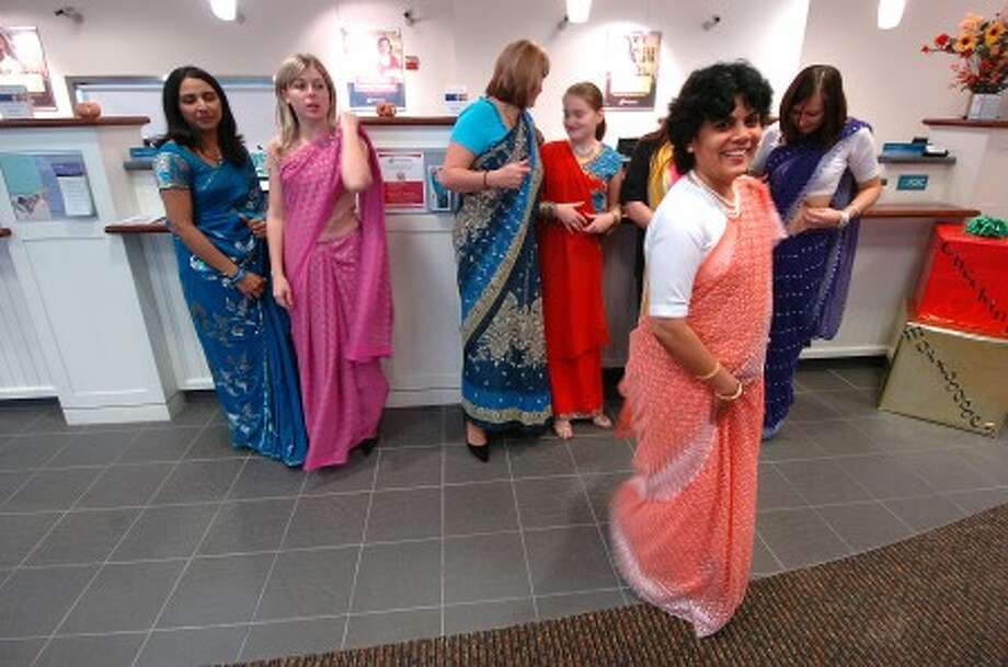 Photo/Alex von Kleydorff. First County Bank Assistant Vice President, Branch Manager Prabhat Jadhav and her staff are dressed to celebrate Diwali at their Darien bank on Saturday.