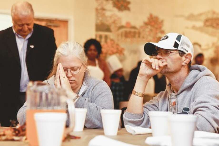 Susan an Army Veteran and her husband Jeff take a moment to give thanks at the Heart-To-Heart Foundations annual Pre-Thanksgiving luncheon held at Calvary Baptist Church Saturday afternoon. Hour photo / DAVID ESPOSITO