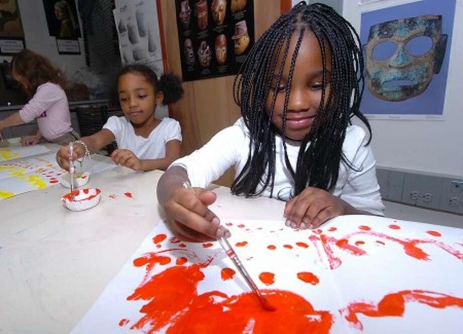 Photo/Alex von Kleydorff. K.T. Murphy school Kindergartener Amya Cooper works on her painting project in Catie Ramsey''s art class.
