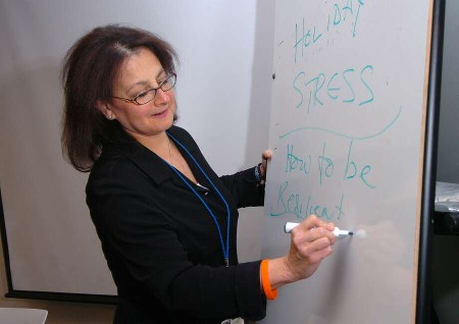Photo/Alex von Kleydorff. Nanette Green offered a seminar on dealing with Holiday stress at the Wilton Library.