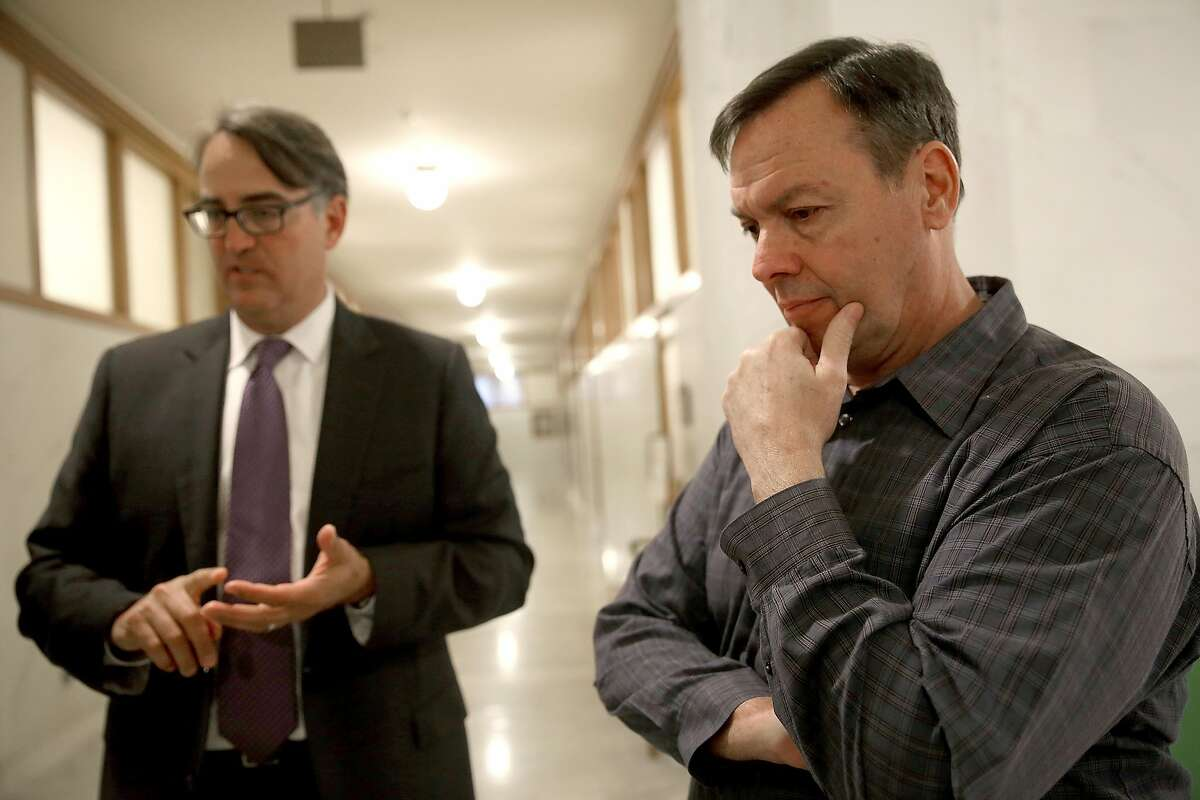 Mike McCowan (right), nephew of David Zeller next to his attorney Carter Zinn (left) at city hall on Thursday, June 16, 2016 in San Francisco, Calif.. David Zeller was paralyzed by CCSF medical staff where a settlement was reach for$1.5 million dollars.