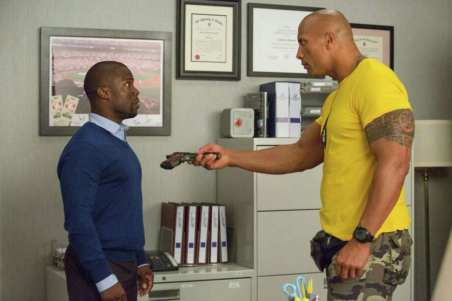 "This image released by Warner Bros. Entertainment shows Kevin Hart, left, and Dwayne Johnson in a scene from, ""Central Intelligence."" (Claire Folger/Warner Bros. Entertainment Inc. via AP) ORG XMIT: NYET303 Photo: Claire Folger / Warner Brothers Entertainment"