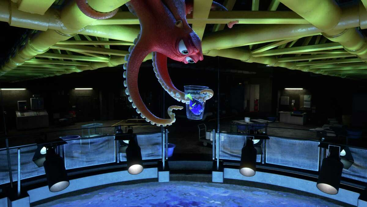 """This image released by Disney shows the characters Hank, voiced by Ed O'Neill, left, and Dory, voiced by Ellen DeGeneres, in a scene from """"Finding Dory."""" (Pixar/Disney via AP) ORG XMIT: NYET781"""