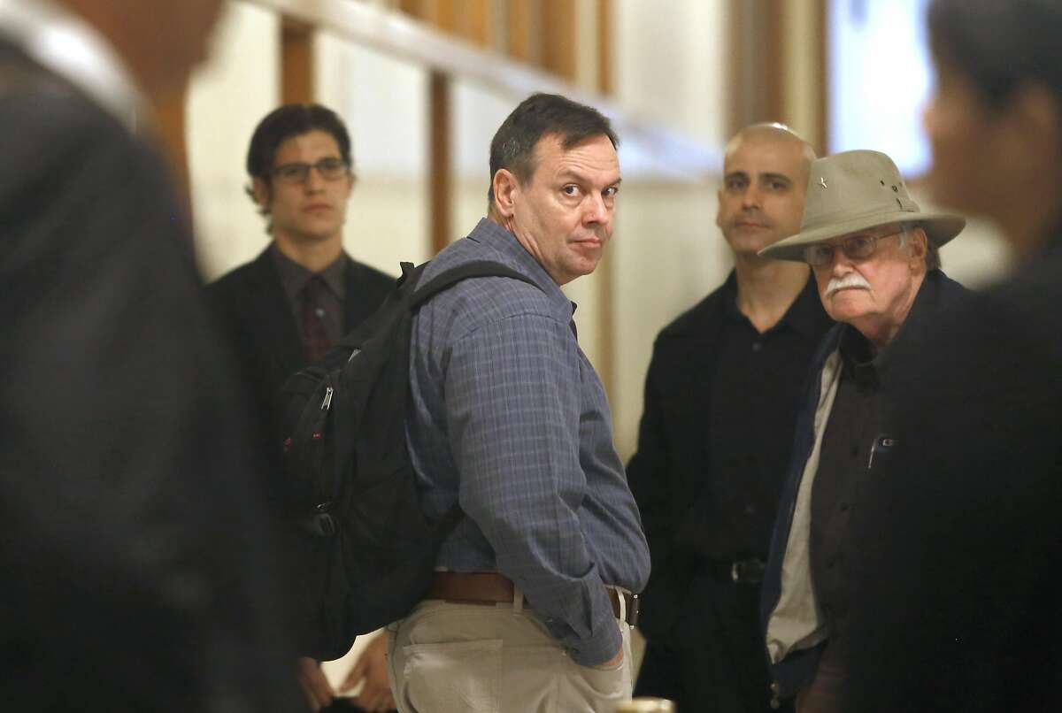 Mike McCowan (middle), nephew of David Zeller at city hall near his counsel on Thursday, June 16, 2016 in San Francisco, Calif.. David Zeller was paralyzed by CCSF medical staff where a settlement was reach for$1.5 million dollars.