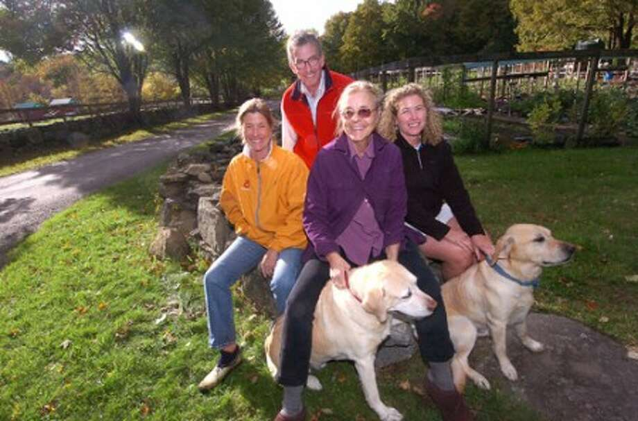 Photo/Alex von kleydorff. At Millstone Farm, l-R Neil Gluckin, Kate Gluckin, Annie Farrell and Betsy Fink along with Odie and Milo, will explaing the history of farming in wilton with a ''Farming Rocks'' peresentation.