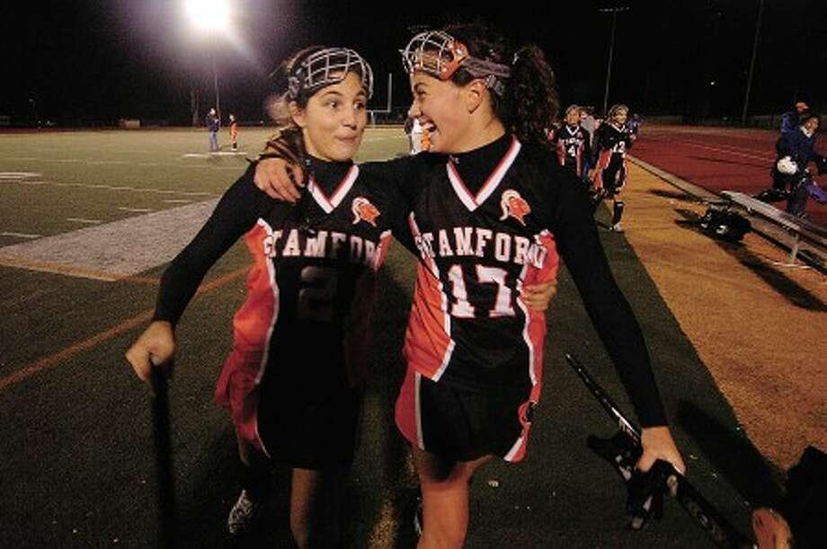 Photo/Alex von Kleydorff. Stamford''s Alexandra Deluca, left, and Shayna Colon celebrate Stamford''s semifinal win.