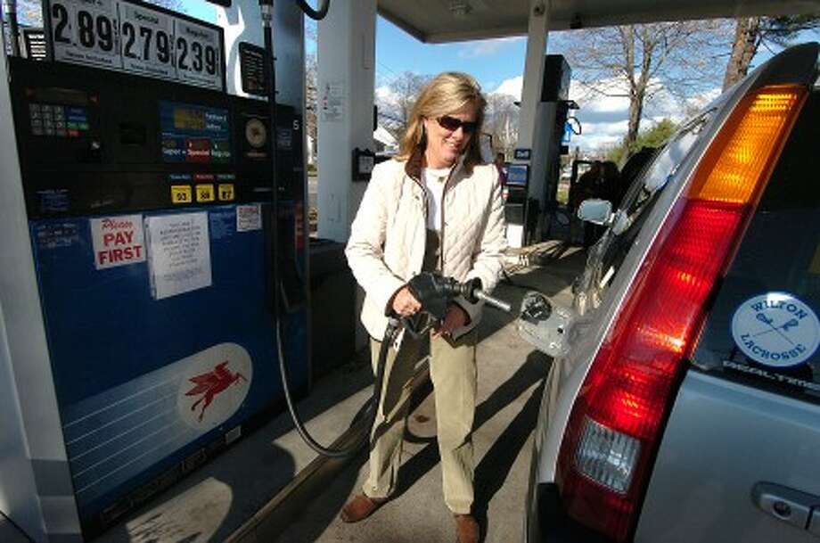 Photo/Alex von Kleydorff. Leslie Hueglin fills up with gas at RT 7 Mobil in Wilton.