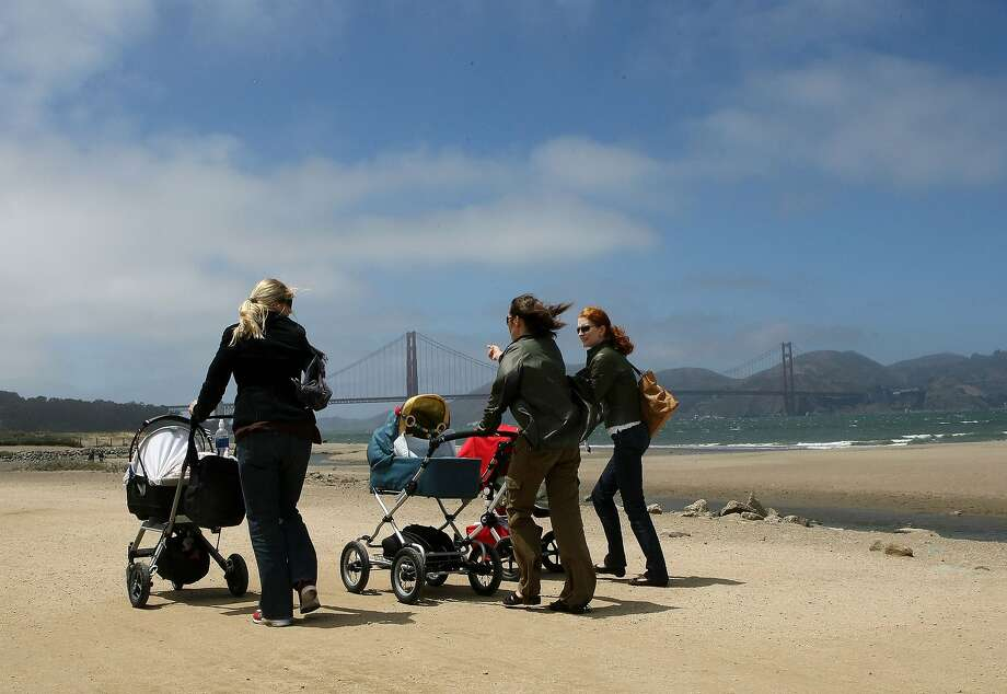 Women push baby carriages as they walk along Crissy Field in San Francisco. Photo: Justin Sullivan, Getty Images