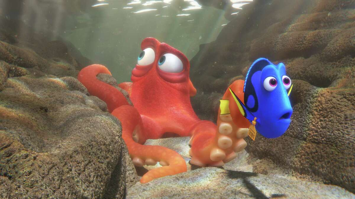 """Hank, left, voiced by Ed O'Neill, helps Dory, voiced by Ellen DeGeneres, navigate a marine complex in """"Finding Dory,"""" the sequel to """"Finding Nemo."""""""
