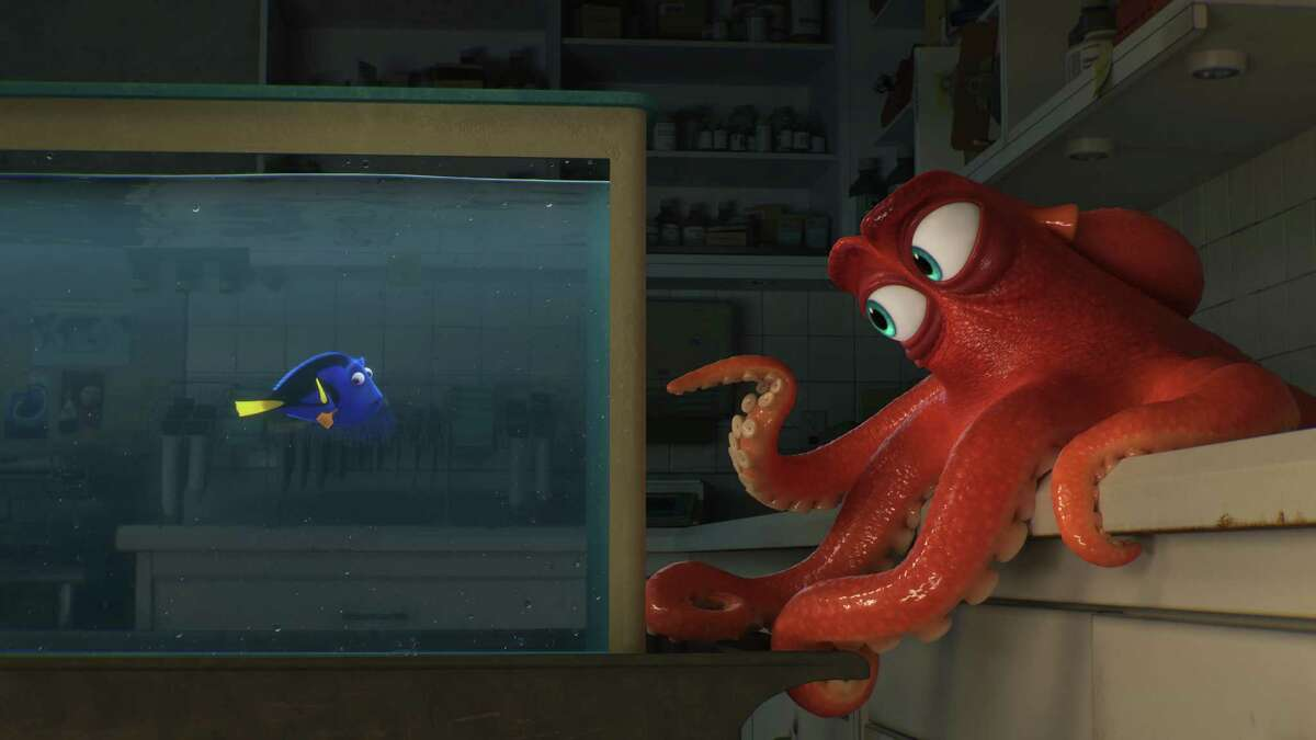 """This image released by Disney shows the characters Hank, voiced by Ed O'Neill, right, and Dory, voiced by Ellen DeGeneres, in a scene from """"Finding Dory."""" (Pixar/Disney via AP)"""