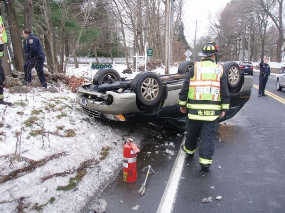 Wilton youth escapes injury after rolling over car in Westport