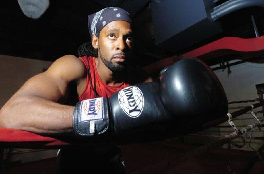 Photo/Alex von Kleydorff. Boxer Ahmad Mickens in the ring at his Revolution Fitness gym.