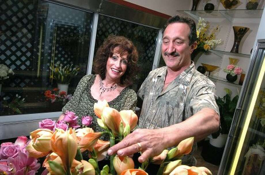 Photo/Alex von Kleydorff. Sales Associate Barbara Shanen helps with arranging a display of Roses and Amaryllis with Stamford Florist owner Jim Ferraro.
