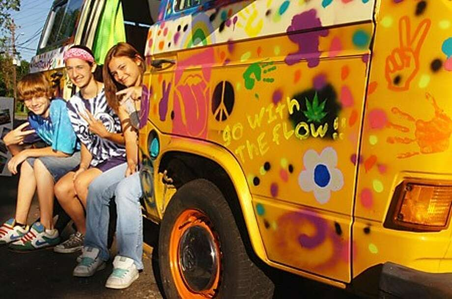 Ponus Ridge Middle School 8th graders Chad Lajoie, Regina Tamburro and Nicole Brenden painted a VW Bus for extra credit for their Social Studies class where they''re learning about the sixties. Hour photo / Erik Trautmann
