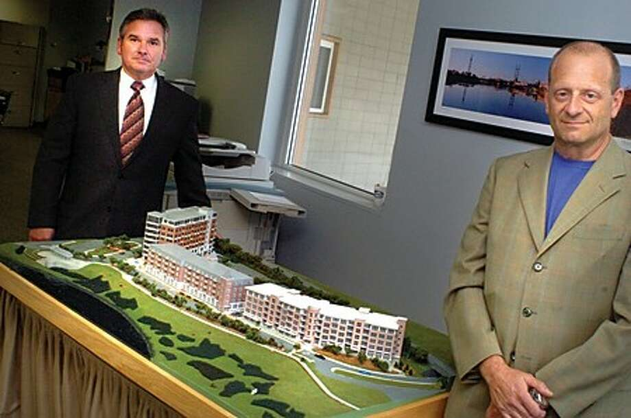 Timothy T. Sheehan Redevelopment Agency Excecuitve Director and Emil Albanese Redevelopment Commision Chairman with a model of Maritime Yards, part of Reed-Putnam Urban Renewal Plan. hour photo/matthew vinci