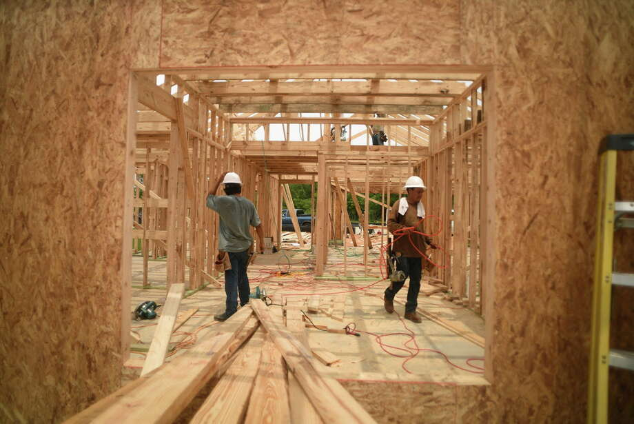 An LGI Homes crew works on a new home on Nina Road in the Chase Run community in Conroe on May 12, 2016. (Photo by Jerry Baker/Freelance) Photo: Jerry Baker, For The Houston Chronicle