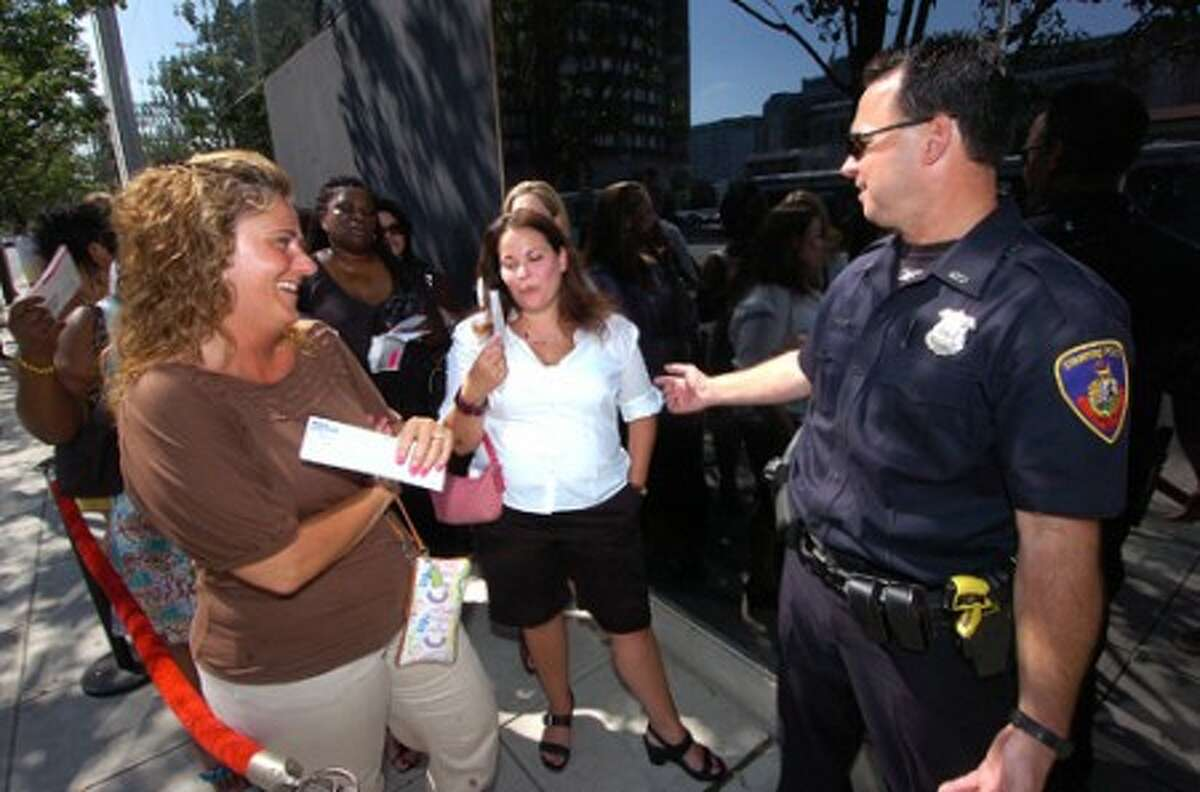 Photo/Alex von Kleydorff. Jerry Springer Fans Maria Belmonte from Stamford and Janet Ziperstein from Newtown are at the front of the line as Police officer David Sileo keeps things organized in front of The Palace theater for the premiere taping of the show.