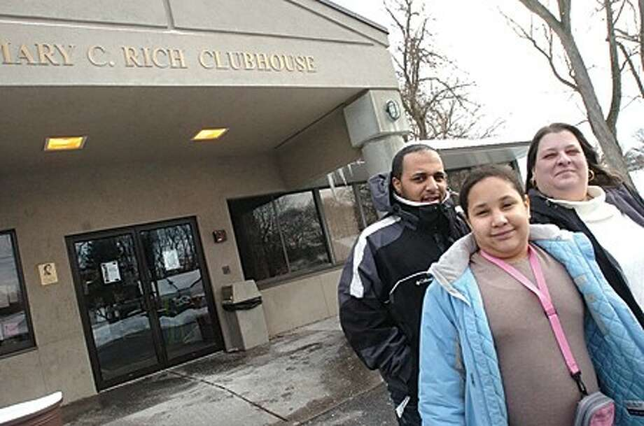 Lisa Barnes with her daughter Kailyn 10 and her son Antonio Perrellis and 17 year old daughter Nicole who is not in the photo were able to stay at various temporary housing through connections with the Boys and Girls Club of Stamford after loosing their Stamford home in a fire/photo matthew vinci