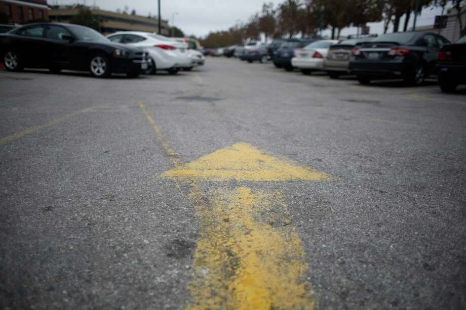 Driveways and parking lots are capital investments that increase the value and functionality of a property. Proper maintenance can extend the life of asphalt surfaces by as much as 300 percent. Sealcoating is the best way to protect pavement. Photo: Lea Suzuki /The Chronicle / ONLINE_YES