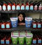 Wholesome sweetners Marketing communications Manager Holly Cassard poses for portrait with some of the companies products Friday, May 27, 2016, in Sugar Land.