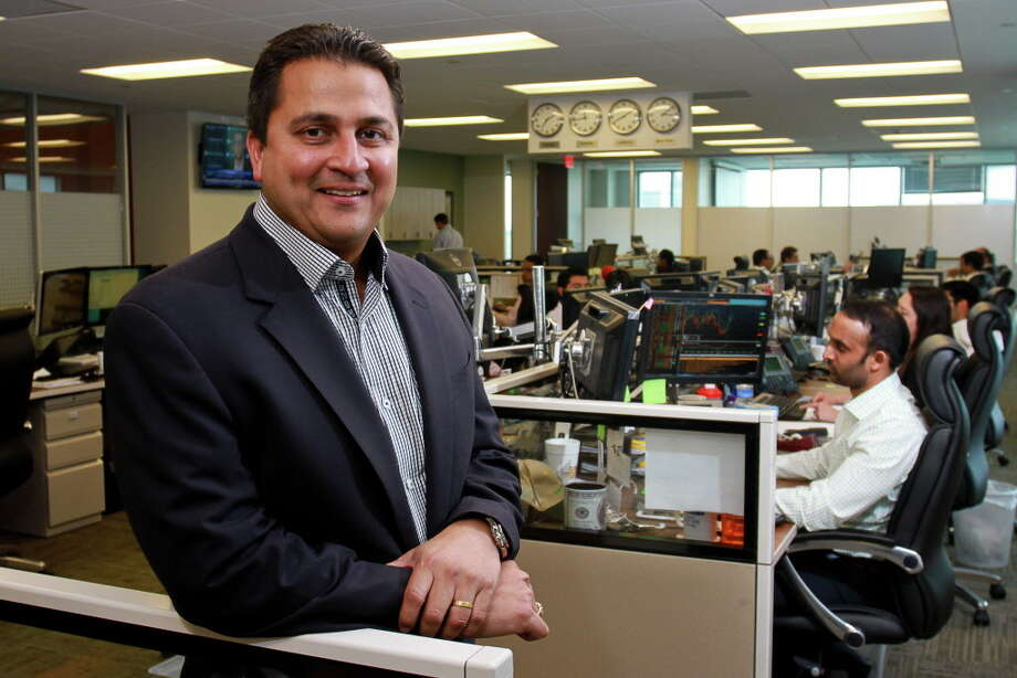 Owner and CEO Amit Bhandari on the trading floor at BioUrja, an energy commodity company which focuses on the purchase and sale of ethanol petroleum products and crude oil. Photo: Gary Fountain, For The Chronicle / Copyright 2015 by Gary Fountain
