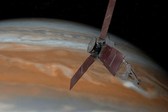 An artist's rendering shows the Juno craft above Jupiter, where it is set to orbit for a year.