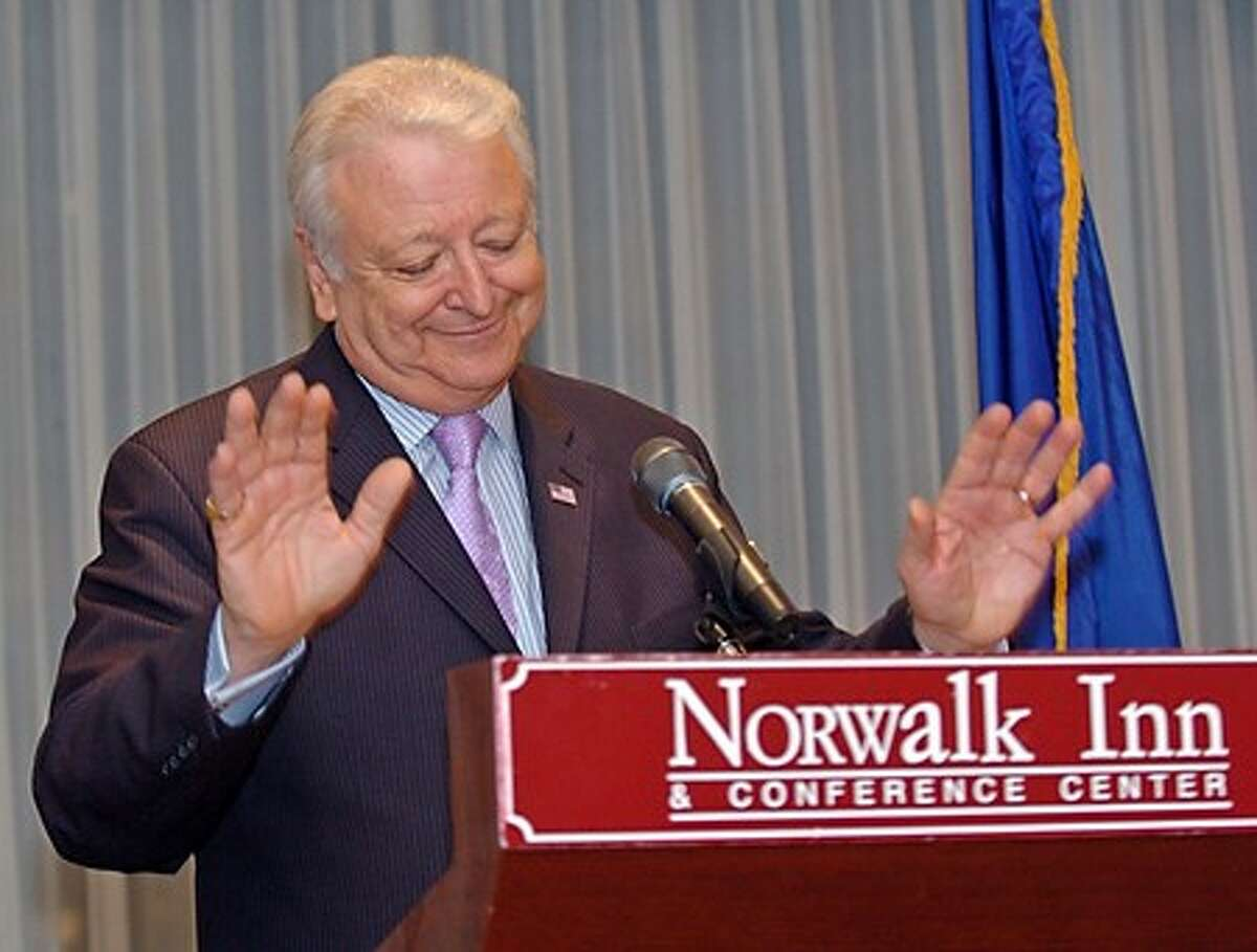 Norwalk''s Mayor Moccia quiets an excited crowd after announcing he will run for a third term Thursday evening at the Norwalk Inn & Conference Center. Hour Photo / Danielle Robinson