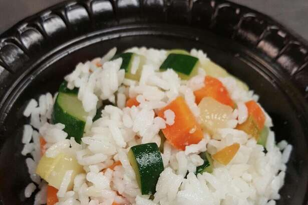 A Houndtree at Rita's on the River: steamed white rice with diced zucchini and diced carrots. On the pet menu.