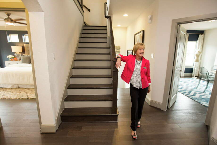Beverly Bradley, senior sales consultant for David Weekley Homes, shows a model home at The Village at Spring Branch. Photo: Brett Coomer, Houston Chronicle / © 2016 Houston Chronicle