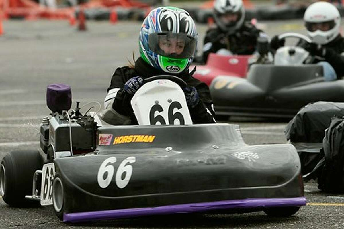Norwalk resident Colleen Pratt, who came in in first place, rounds a corner as go-kart racing resumed this Saturday at the Calf Pasture Beach parking lot after a several month long hiatus do to construction work at the site. Hour photo / BEN GANCSOS