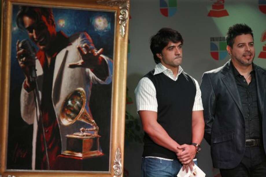 Latin pop singer Luis Fonsi, left, and Salsa vocalist Luis Enrique, right, listen as the nominees for the 10th Annual Latin Grammy Awards are announced Thursday, Sep. 17, 2009 at the Conga Room at the L.A. LIVE in Los Angeles. (AP Photo/Damian Dovarganes)