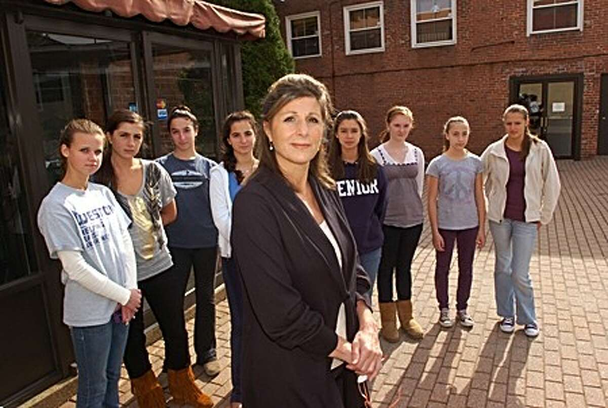 Nanette Vallas of Ballet Etude and some of her students in the courtyard that will share an entrance with a proposed liquor store only doors down from their studio. Vallas is circulating letter in oppostion to proposed liquor store for the 94 Wall St. Hour photo / Erik Trautmann