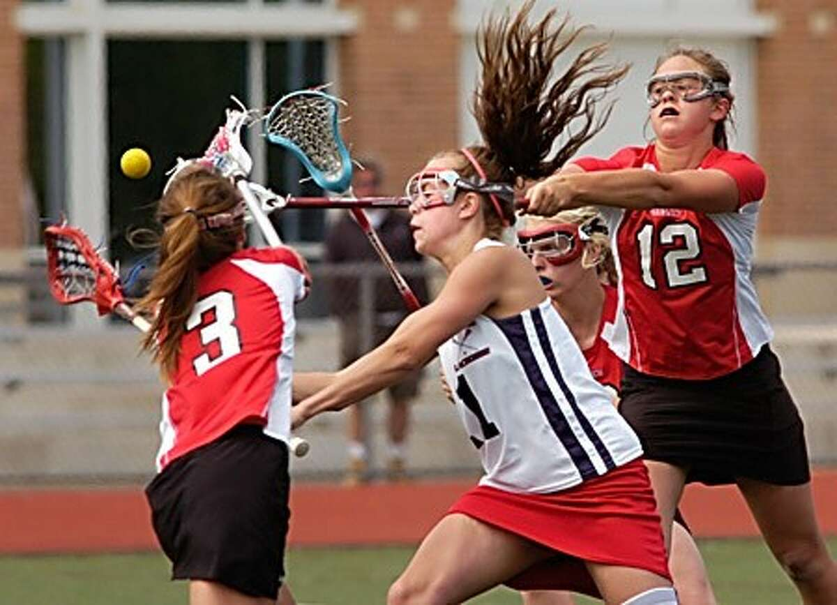 #11 for BMHS, Leia Cadotte, drives through two defenders to to take a shot on goal while playing against Greenwich Saturday. Hour photo / Erik Trautmann