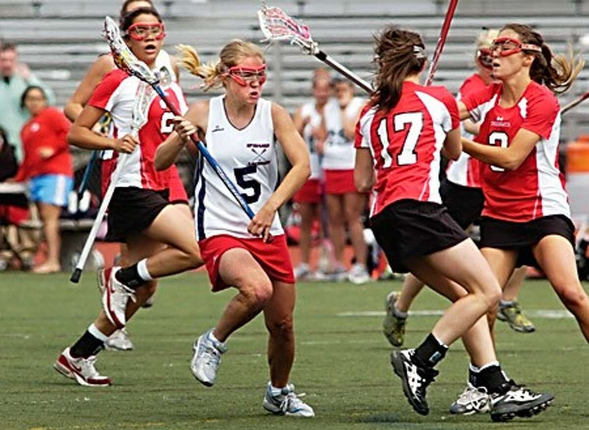 #5 for BMHS, Madonna Wadolowski, drives through the defense to score one of her many goals against Greenwich Saturday. Hour photo / Erik Trautmann