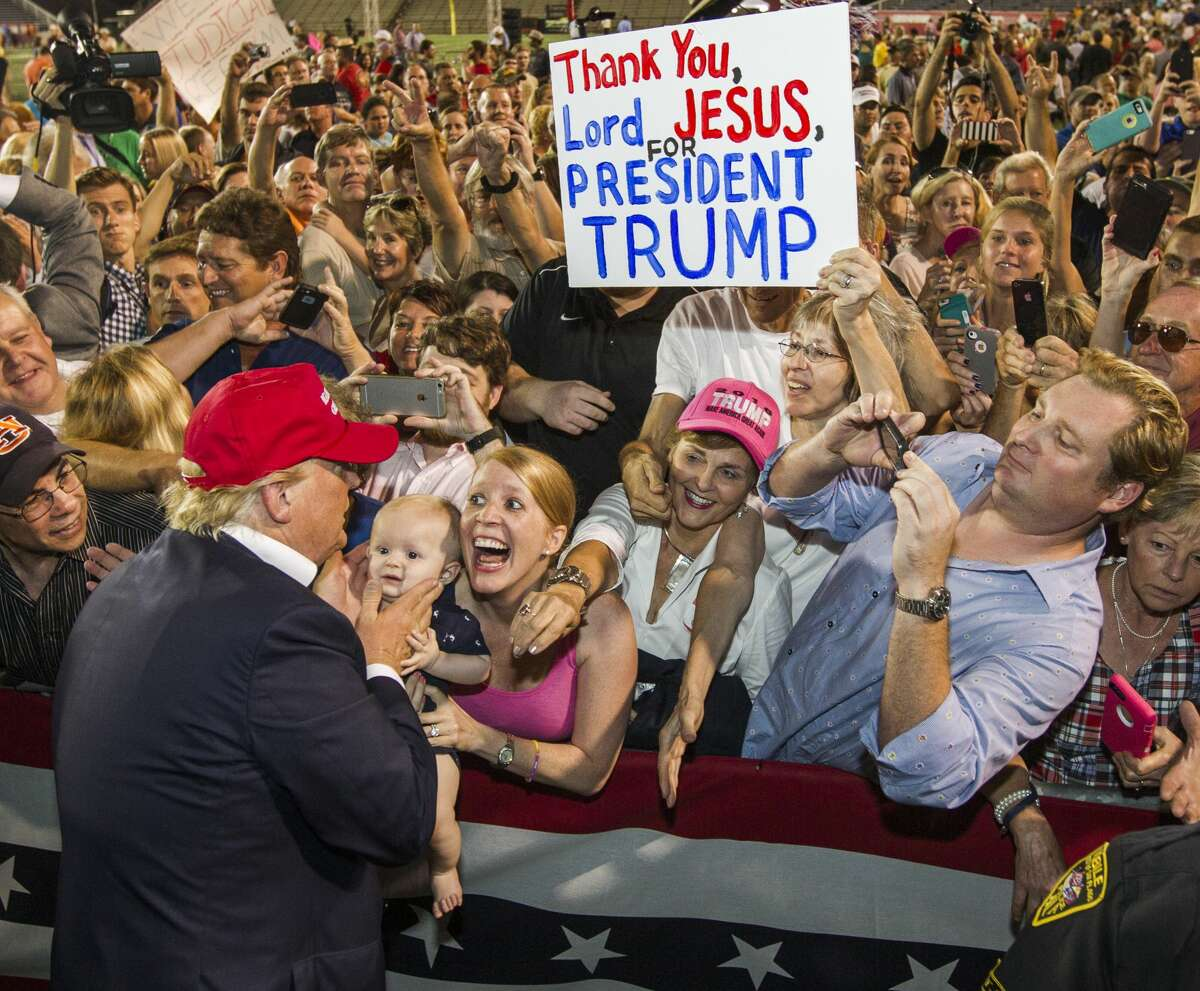 MOBILE, AL- AUGUST 21: Republican presidential candidate Donald Trump greets supporters after his rally at Ladd-Peebles Stadium on August 21, 2015, in Mobile, Alabama. The Trump campaign moved the rally to a larger stadium to accommodate demand. (Photo by Mark Wallheiser/Getty Images)