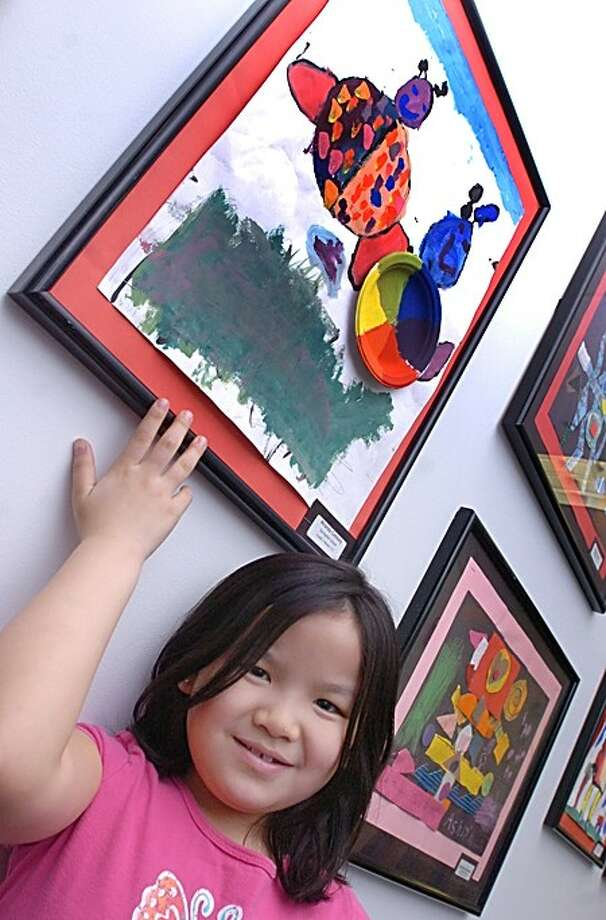 Springdale school student, Miranda Connolly shows off her painting of lady bugs at the Young at Art show held at the University of Bridgeport at Stamford on Monday/hour photo matthew vinci