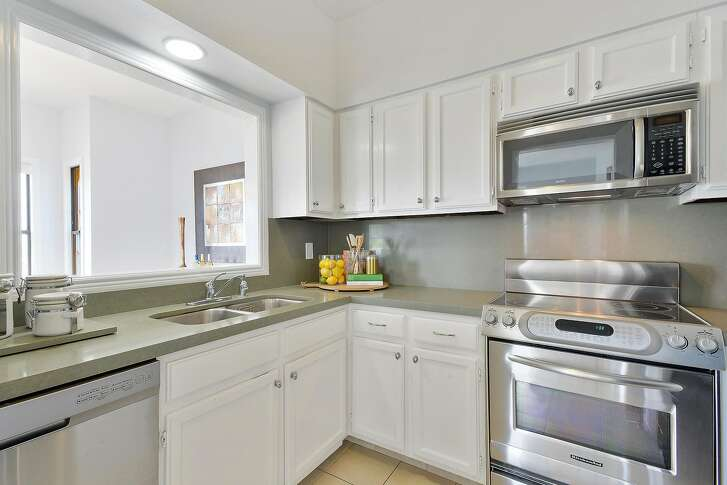 The Potrero Hill condo includes a remodeled kitchen that looks into the dining room.