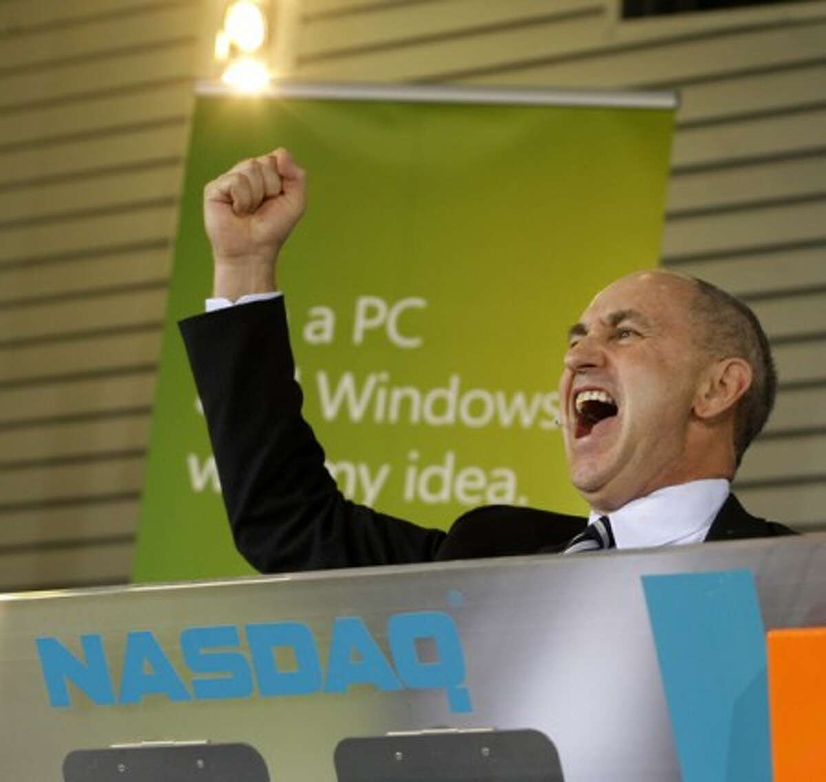 Chris Liddell, CFO of Microsoft Corp., yells as he tries to fire up a crowd of Microsoft employees prior to the start of a rally to celebrate the release of Windows 7 at the Microsoft Campus Thursday, Oct. 22, 2009, in Redmond, Wash. During the gathering Liddell pushed a button to officially start the NASDAQ stock market trading day. (AP Photo/Ted S. Warren)