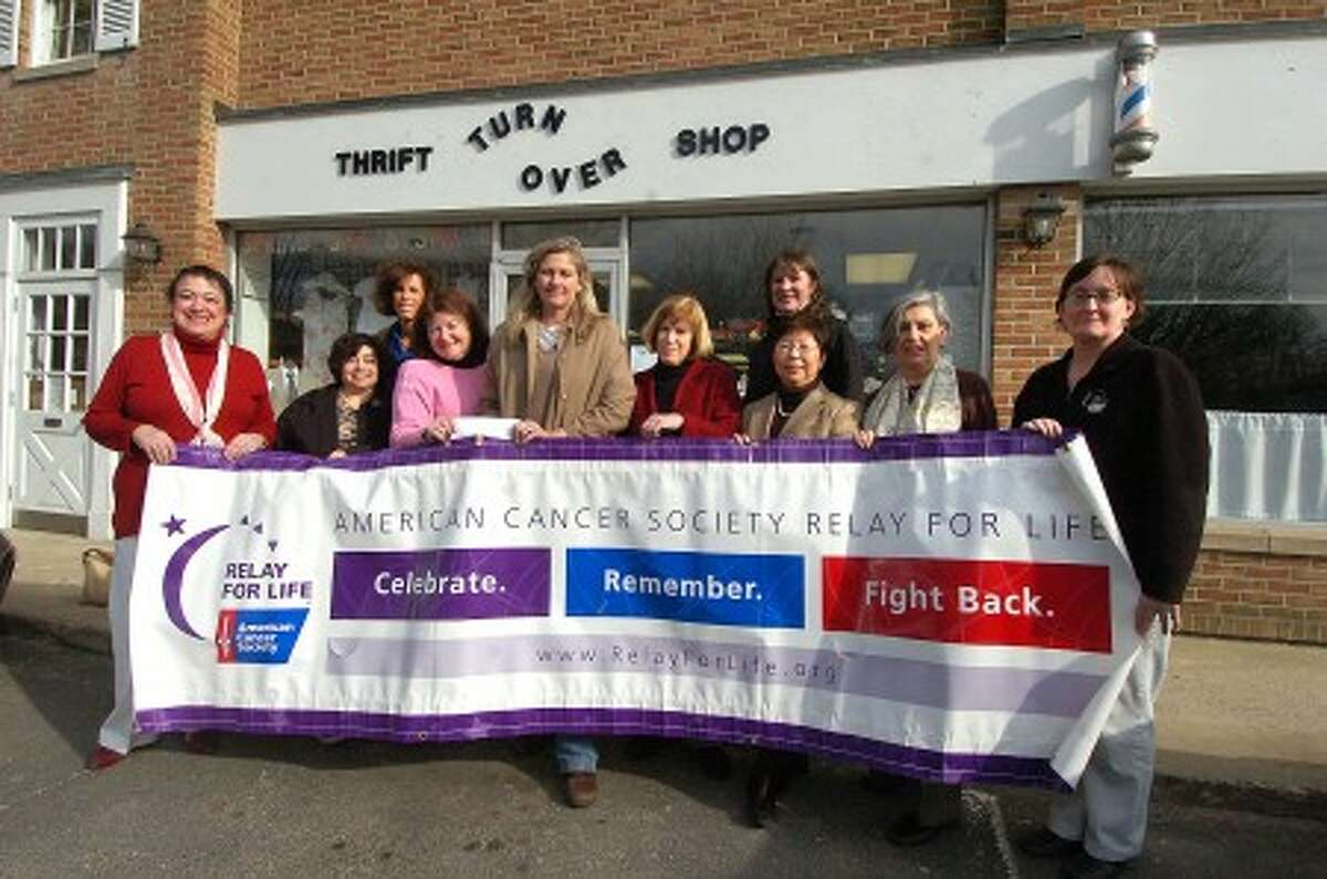 Photo/Alex von Kleydorff. l-r front. Gladys O''Neil, Judy Rin. Sharon Sobel, Beth Kohl, Noel Konrad Mary Holaday, Novella Tortorella, Pat Deushele. Back l-r Debbie Friedman and Christine Early. collect a check for Relay for Life at The Turn Over shop in Wilton