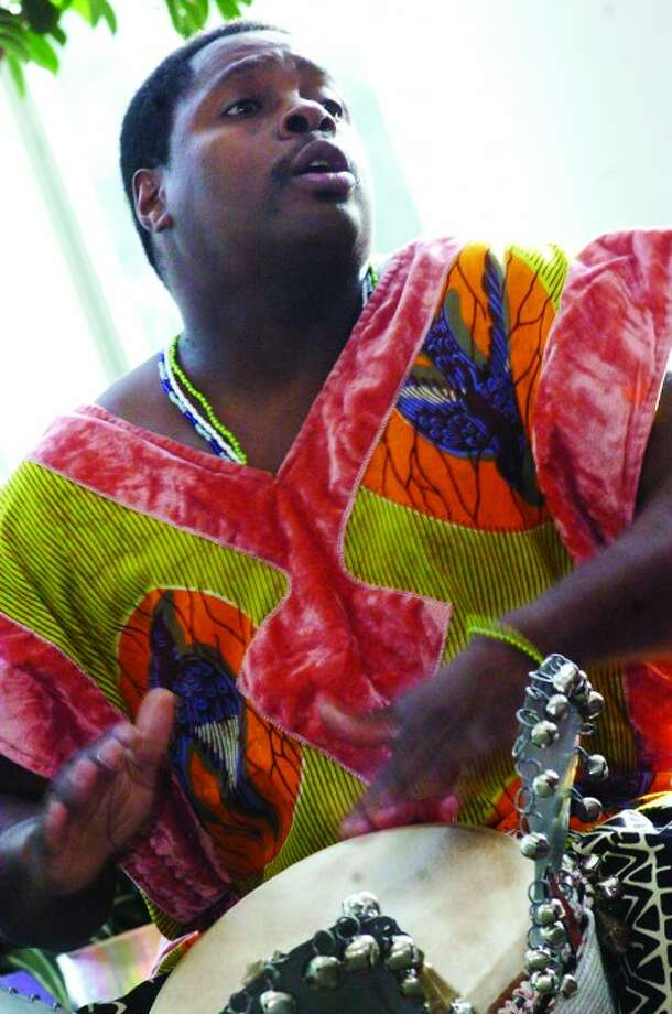 Kwame Henry Jones leads the percussion at the 15th Annual Mayor''s Kwanzaa Celebration Wednesday at the Stamford Government Center/photo matthew vinci