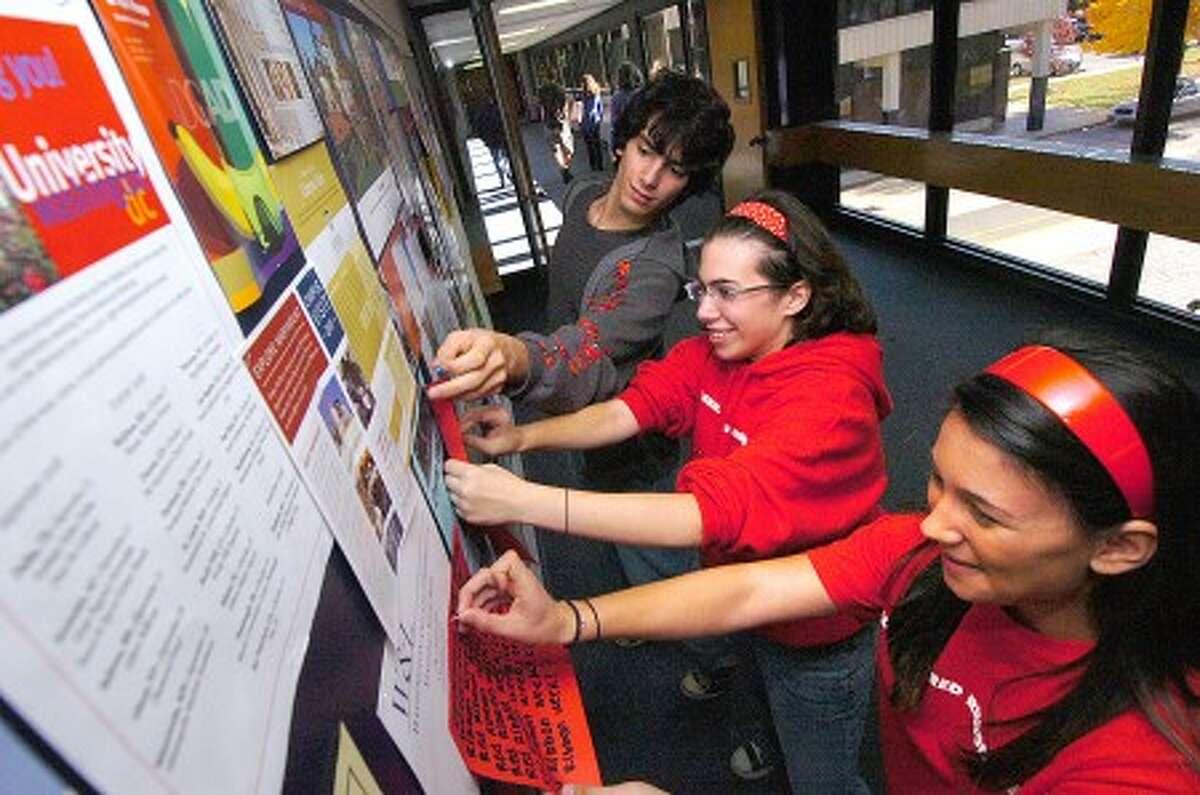 Photo/Alex von Kleydorff. l-r Sophmore Frank Ball, Senior Chloe Rosen and Senior Theresa Marino get the word out about Red Ribbon Day at Wilton High School