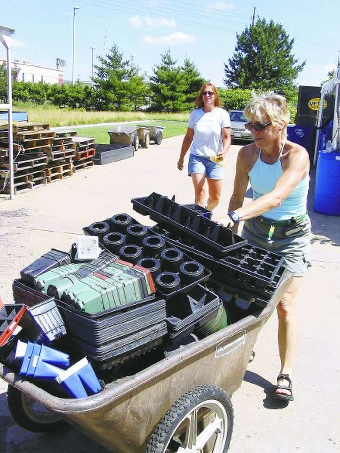 Plastic pots, flats and tray are collected at the Missouri Botanic Garden. MCT photo