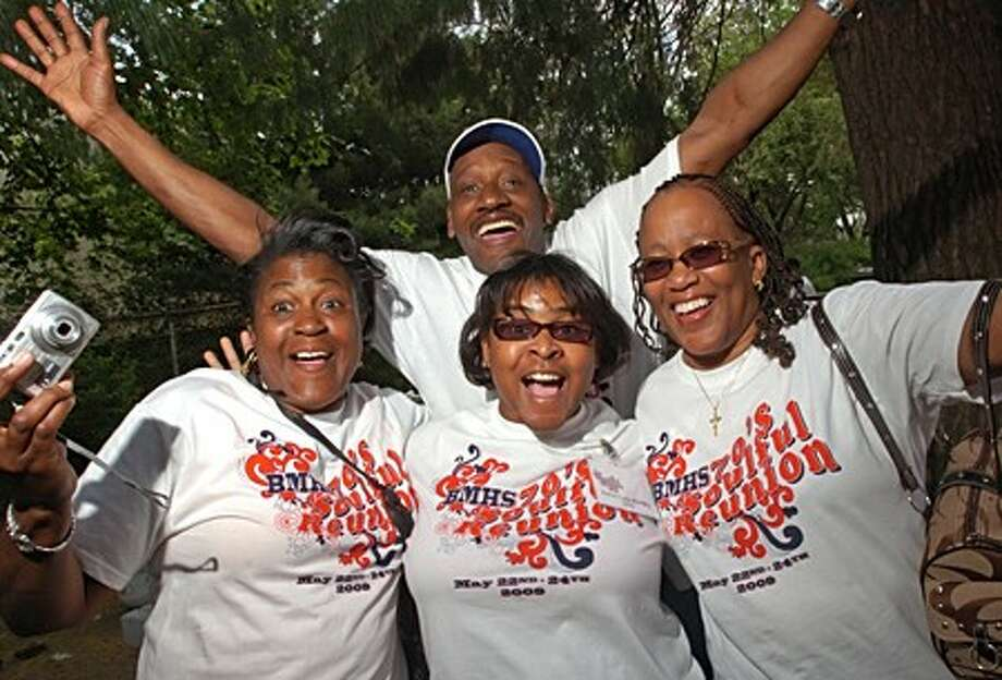 "BMHS alumni from the class of ''75; Alicia Gilliam Carter, Darryl ""Rock"" Ross, Karen Lynn Bradley and Nina Green reunite at the Souful Seventies Reunion barbeques at the Carver Center Saturday afternoon. Hour photo / Erik Trautmann"